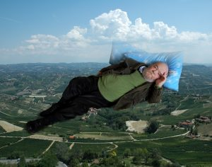 GIANT LYING ON PILLOWS AND CLOUDS.